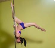 Woman`s pole dancing flexibility Royalty Free Stock Photos