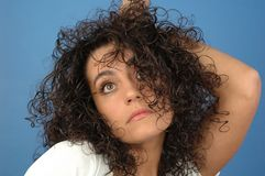 Woman's portrait. Curly woman Stock Photo