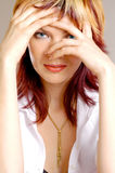 Woman`s portrait. Close up portrait of young woman playing hide and seek Royalty Free Stock Image