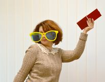 The woman`s portrait in big sunglasses with a mirror in a hand Royalty Free Stock Images