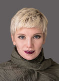 Woman`s portrait blonde.  Fashion hairstyle, make-up in grey shades. Royalty Free Stock Images