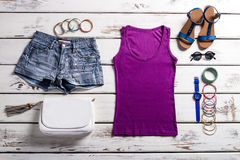 Woman's purple top and shorts. royalty free stock image