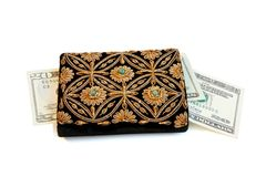 Woman's purse and dollars isolated Stock Photography