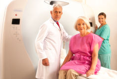Woman in 60s ready to be checked under mri scanner with senior d Stock Image