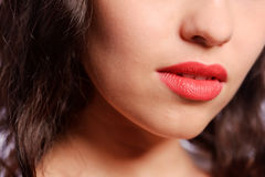 Woman's red lips Stock Images