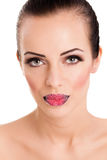 Woman's  red lips coated with scattered sugar Royalty Free Stock Photos