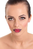 Woman's  red lips coated with scattered sugar Royalty Free Stock Photography