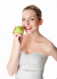 Woman S Red Lips On An Apple Royalty Free Stock Images