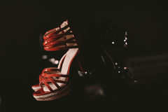 Woman's red sandals. In dark ambient Royalty Free Stock Photography