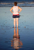 Woman's reflection in wet sand on Australian beach Stock Photography