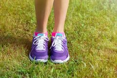 Woman's running shoes on grass Royalty Free Stock Images