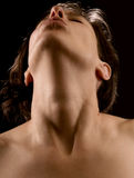A woman's sensual pleasure. Intimate portrait of young woman with arched neck, at a moment of sensual pleasure Stock Photography