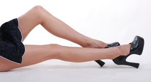 Woman's sexy legs in black shoes Royalty Free Stock Images