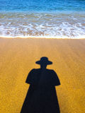 Woman in Hat Shadow on Beach Royalty Free Stock Image