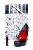 Woman's shoe, lipstick and gift Royalty Free Stock Images