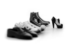 Woman's Shoe. Stand out woman's shoe in a row of men's shoes Royalty Free Stock Image