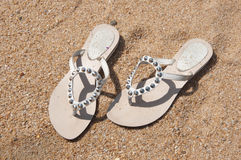 Woman's shoes on the beach Royalty Free Stock Photography
