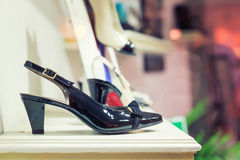 Woman's shoes on the show case Stock Image