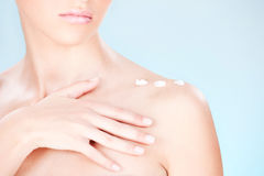 Woman's shoulder with cream. Cosmetic cream on woman's shoulder stock photos