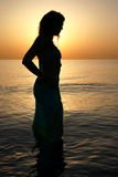 Woman's silhouette. Woman silhouette on the beach at sunrise Stock Photography