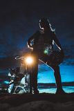 The woman's silhouette against the motorcycle Royalty Free Stock Photo