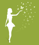 Woman's silhouette on green