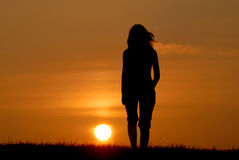Woman's silhouette at sunset Stock Photos