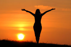 Woman's silhouette at sunset Stock Photography