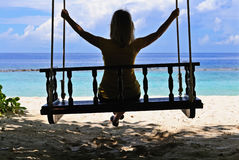 Woman's silhouette on a swing Stock Photo