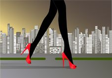 Woman`s slender legs in red high-heeled shoes Stock Photos
