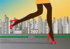 Woman`s slender legs in red high-heeled shoes run on the road  Royalty Free Stock Photo