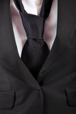 Woman's suit and tie Stock Image