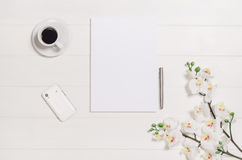Woman's table, desk or workspace seen from above. Top view background with white wood and copy space. Feminine, elegant woman's white, wooden table, desk or stock image