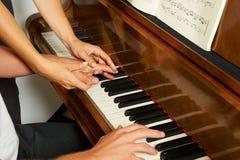 Woman's teaching the piano closeup Royalty Free Stock Photos