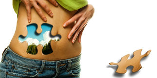 Womans waist and puzzle Stock Photo