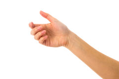 Woman's white hand holding something. On white background in studio Royalty Free Stock Image