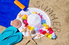 Woman's white hat on the sandy beach Stock Image