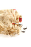 Woman's wig, nail varnish, red lipstick Stock Images