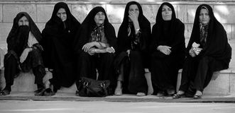 This Woman's Work. Women gathering in a marketplace in Iran in Muslim garb Stock Photo