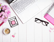 Woman`s workplace with stylish accessories and flowers Royalty Free Stock Image