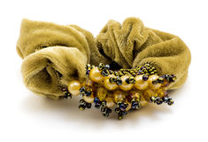 Woman's yellow scrunchy (hairpin) with jewelry isolated Stock Photos