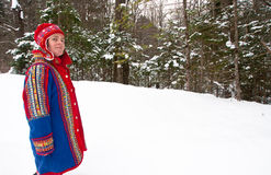 Woman in Saami hat and blue felt coat Stock Photos