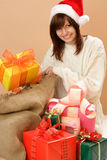 Woman with sack of christmas gifts Royalty Free Stock Photo