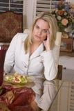 Woman sad eating salad Royalty Free Stock Photos