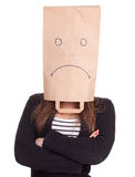 Woman in sad ecological paper bag on head Stock Photos