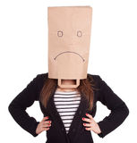 Woman in sad ecological paper bag on head Stock Photo