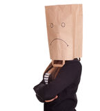 Woman in sad ecological paper bag on head Royalty Free Stock Image