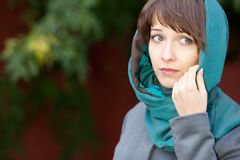 Woman with sad eyes in scarf outdoors Stock Photo