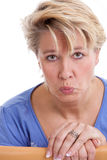 Woman with sad face. Mature woman pulling a sad face royalty free stock image