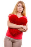 Woman sad girl hugging red heart love symbol Royalty Free Stock Image